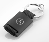 Брелок Mercedes-Benz Key Ring, black/silver, diecast zinc/leatherette, артикул B66956287